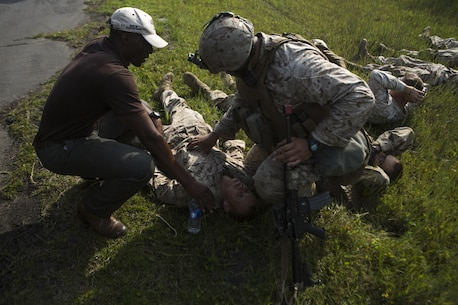 U.S. Marines and a civilian assigned to Marine Corps Security Force Regiment, Fleet Antiterrorism Security Team (FAST) Company, Fifth Platoon, participate in a casualty evacuation (CASEVAC) drill near Marine Corps Air Station New River, N.C., Sept. 2, 2015. VMM-365 supported FAST Marines by providing a means of quickly evacuating simulated casualties during a CASEVAC drill.