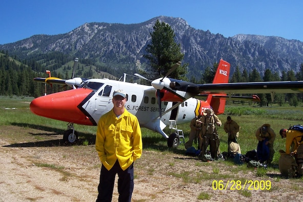 "Col. Paul ""Buster"" Delmonte, the Emergency Preparedness Liaison Officer for Utah, is a lead plane pilot for the U.S. National Forest Service. He is pictured here with one of his aircraft, a DHC-6 Twin Otter."