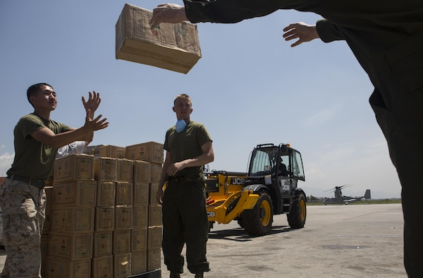 U.S. Service members with the Joint Task Force 505 prepare boxes of aid and relief supplies to be loaded onto an aircraft at Tribhuvan International Airport, Kathmandu, Nepal, May 14, in order for the supplies to be delivered to remote locations during Operation Sahayogi Haat. JTF 505 along with other multinational forces and humanitarian relief organizations are currently in Nepal providing aid after a 7.8 magnitude earthquake struck the country, April 25 and a 7.3 earthquake on May 12. At Nepal's request the U.S. government ordered JTF 505 to provide unique capabilities to assist Nepal. (U.S. Marine Corps photo by MCIPAC Combat Camera Staff Sgt. Jeffrey D. Anderson/Released)