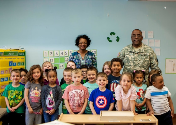 """DLA Distribution commander Army Brig. Gen. Richard Dix reads """"If You Give a Mouse a Cookie"""" to one of the classrooms at the Defense Distribution Center Susquehanna Child Development Center, in honor of Month of the Military Child on April 29."""
