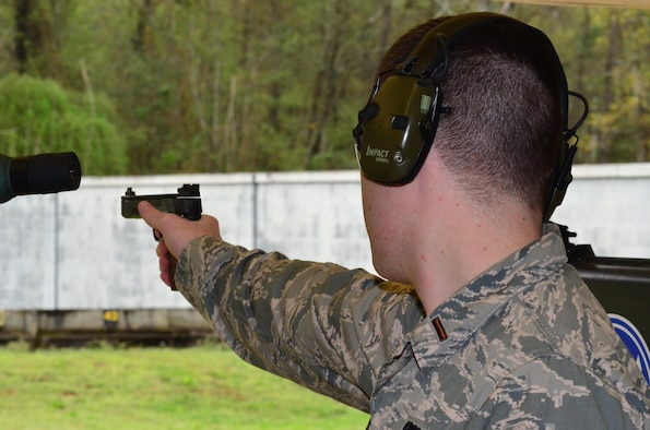 Second Lt. Tucker Sears, the 436th Logistics Readiness Squadron material management officer in charge, shoots a .22-caliber pistol during Team Camp March 24, 2015, at Fort Benning, Ga. At Team Camp, Sears earned a spot on the Air Force National Pistol Team and has already competed in two competitions and placed first on the Air Force's Silver Team at the NRA National Outdoor Rifle and Pistol Championships at Camp Perry, Ohio. (U.S. Air Force photo/Lt. Col. Hugh M. Ragland)
