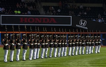 The Marine Corps Silent Drill Platoon performs for baseball fans before a New York Mets and Yankees game at Citi Field in Flushing, N.Y., Sept. 19, 2015. Marines with the 24-man rifle-platoon are infantryman by trade and were selected to be a part of the ceremonial unit. The platoon is based out of Marine Barracks Washington, D.C.  (U.S. Marine Corps Photo by Sgt. Zachary W. Scanlon/Released)
