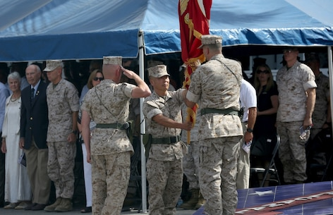 Brig. Gen. Daniel D. Yoo (center), hands the 1st Marine Division colors to Maj. Gen. Daniel J. O'Donohue (right) during the change of command ceremony, symbolizing the passing of duties and responsibilities as the commanding general, aboard Marine Corps Base Camp Pendleton, Calif., Sept. 10, 2015. O'Donohue is taking command of the division after recently commanding Marine Corps Forces Cyberspace Command. (U.S. Marine Corps photo by Staff Sgt. Bobbie A. Curtis)