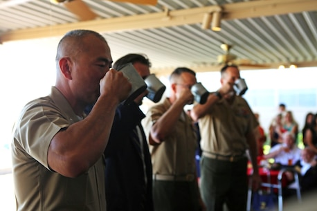 "Lieutenant Colonel Brian S. Middleton, the commanding officer of 3rd Battalion, 4th Marines, 7th Marine Regiment, 1st Marine Division, takes part in the unit's Thunder Mug Ceremony aboard Marine Air Ground Combat Center Twentynine Palms, Calif., Sept. 17, 2015. 3/4 took part in the Thunder Mug Ceremony after reactivating the battalion. The Marine Corps' reactivation of the ""Thundering Third"" officially starts Oct. 1, 2015, which marks exactly 90 years of dedicated service within the Corps."