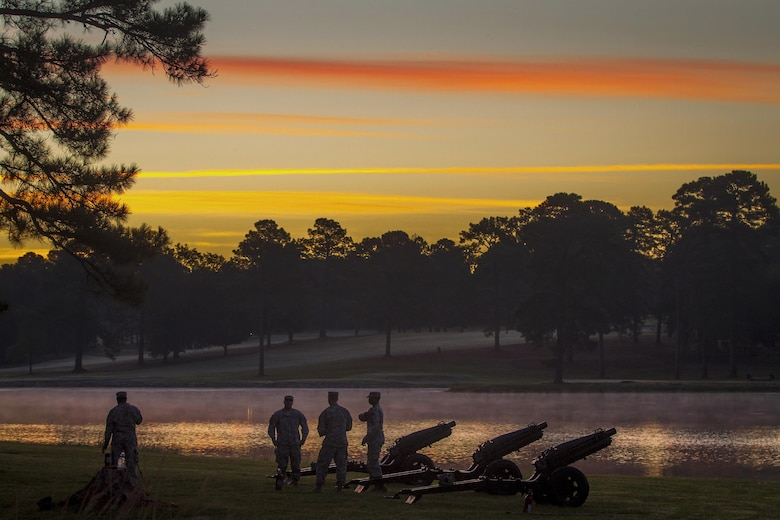 """Soldiers prepare three M116 pack howitzers, the oldest of which was commissioned in 1938, for a change of command ceremony for the Army Reserve's 108th Training Command as the sun rises at Fort Jackson, S.C., Sept. 19, 2015. The soldiers are assigned to Troops Battalion Salute Battery, 171st Brigade. The M116's are called """"pack"""" howitzers because they were originally pulled by pack animals. U.S. Army photo by Sgt. Ken Scar"""