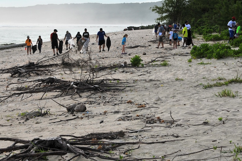 Members of Team Andersen participate in Guam's 20th International Coastal Cleanup Sept. 19, 2015, at Tarague Beach on Andersen Air Force Base, Guam. More than 140 volunteers collected 22 bags of trash and 10 bags of recyclables from the base beach during the annual event. (U.S. Air Force photo by Tech. Sgt. Melissa B. White/Released)