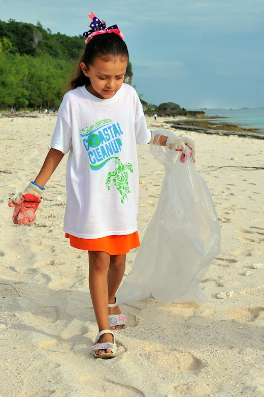 A Team Andersen family member participates in Guam's 20th International Coastal Cleanup Sept. 19, 2015, at Tarague Beach on Andersen Air Force Base, Guam. More than 140 volunteers collected 22 bags of trash and 10 bags of recyclables from the base beach during the annual event. (U.S. Air Force photo by Tech. Sgt. Melissa B. White/Released)