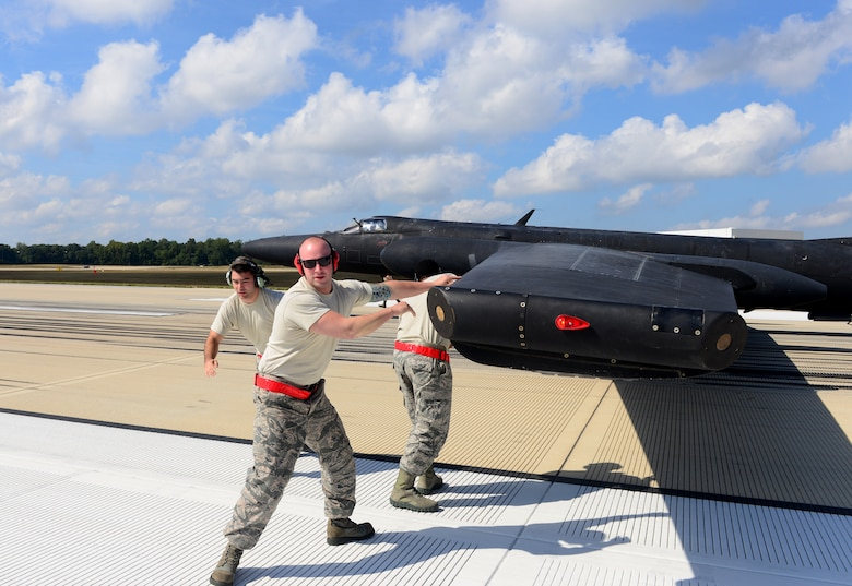 Airmen from the 9th Aircraft Maintenance Squadron, Beale Air Force Base, California, install pogos underneath the wings of a U-2 Dragon Lady during an air show at Joint Base Andrews, Maryland, Sep. 19, 2015. This year marks the 60th anniversary of the U-2, one of the oldest operational aircraft in the Department of Defense. (U.S. Air Force photo by Senior Airman Bobby Cummings)