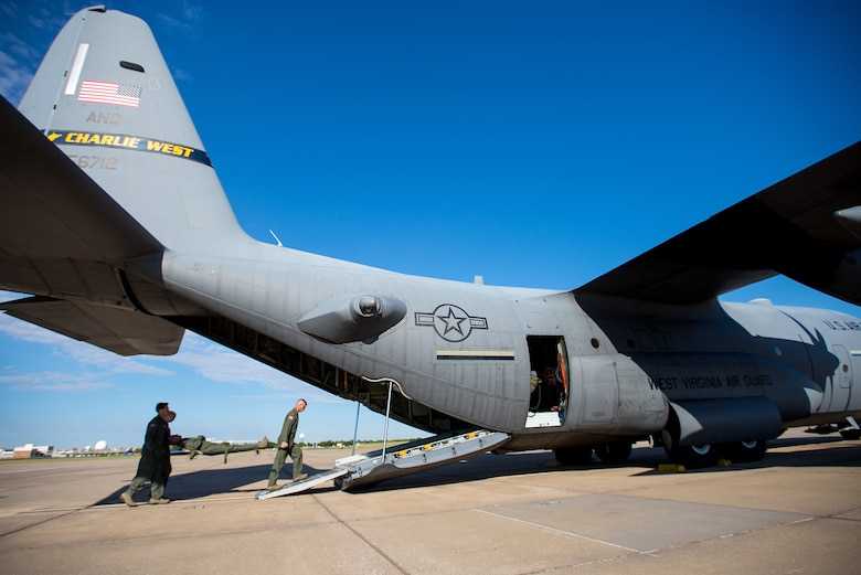 Airmen of 137th Aeromedical Evacuation Squadron, Oklahoma Air National Guard, load medical supplies and simulated patients onto a C-130 Hercules flown by the 130th Airlift Wing, West Virginia ANG, as part of a joint ANG training mission, Sep. 12, 2015. The training helped 137 AES Airmen experience different airframes and new flight crews while maintaining flight readiness. (U.S. Air National Guard photo by Senior Airman Tyler Woodward/Released)