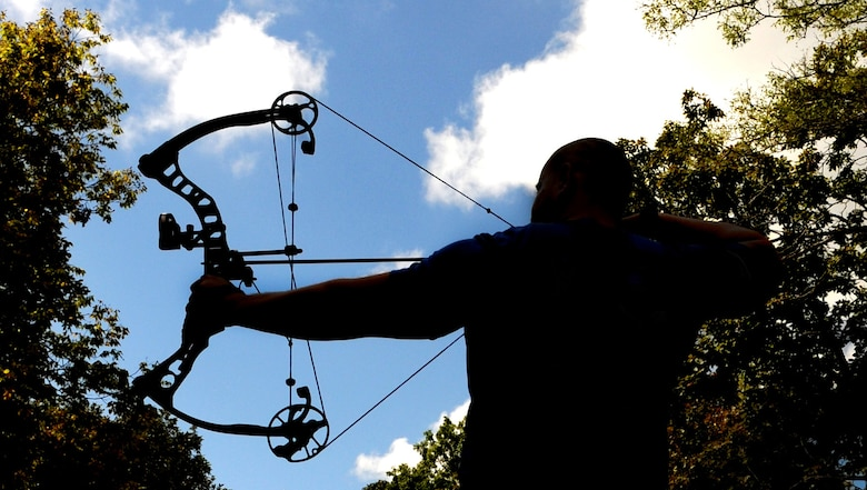 Tech. Sgt. David Hernandez, 509th Logistics Readiness Squadron resource advisor assistant, practices archery Sept. 9, 2015, in Knob Noster, Mo. Hernandez took third place in an archery competition against wounded warriors like himself. Hernandez has been practicing archery since he was young. (U.S. Air Force photo by Airman 1st Class Michaela R. Slanchik/Released)