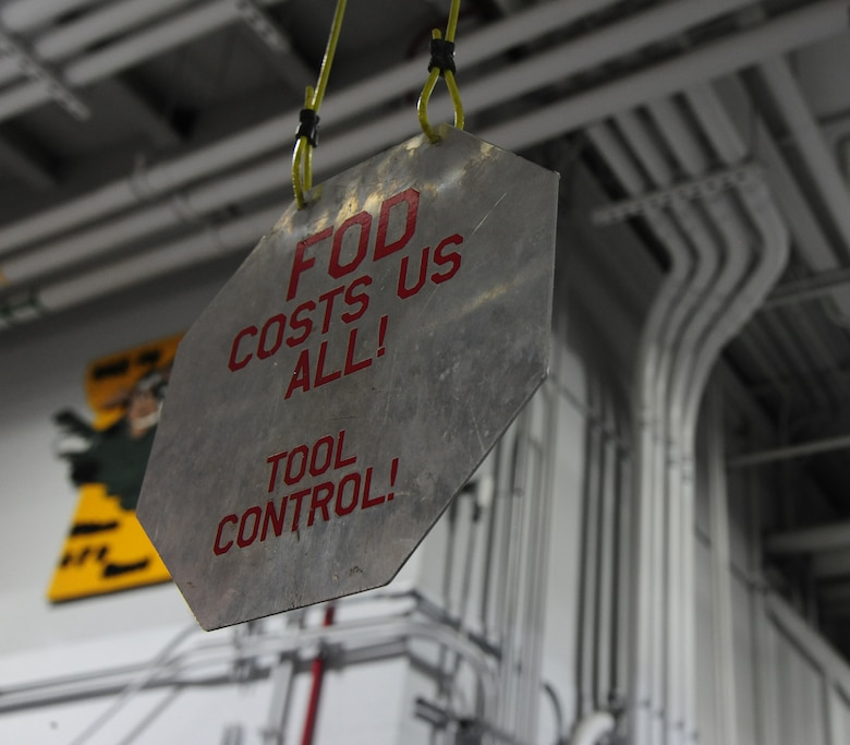 A sign hangs from the ceiling in the structural maintenance shop at Whiteman Air Force Base, Mo., Sept. 15, 2015. The structural maintenance shop prides themselves in ensuring quality work is performed at all times when handling aircraft parts. (U.S. Air Force photo by Senior Airman Keenan Berry/Released)