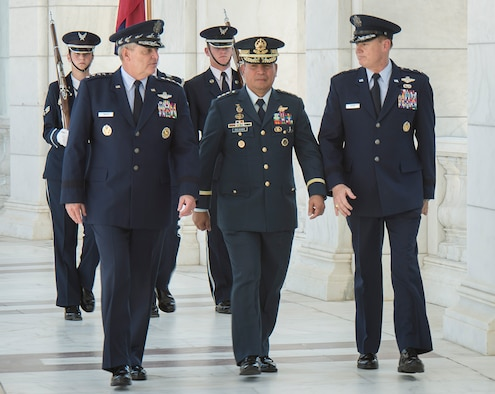 Air Force Chief of Staff Gen. Mark A. Welsh III, Philippine Air Force Commanding General Lt. Gen. Jeffrey Delgado and Air Force District of Washington Commander Maj. Gen. Darryl Burke talk before a wreath laying ceremony at the Tomb of the Unknown Soldier at Arlington National Cemetery Sept. 18, 2015. Delgado visited as part of the Pacific Air Chiefs' Symposium, one of the Air Force's multilateral engagement opportunities used to build relationships with Pacific countries and to enhance theater security cooperation. The Air Force District of Washington brings air, space and cyberspace capabilities to the joint team protecting the nation's capital, and supports local personnel and those serving worldwide. (Photo/ Jim Varhegyi)
