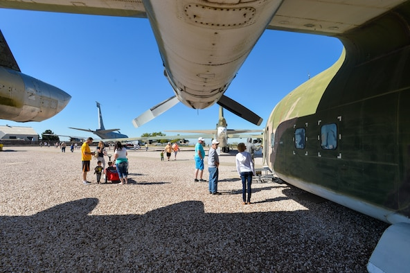 Attendees look at a C-123 Provider aircraft during the Wings and Wheels Car Show and Food for Life event at the Hill Aerospace Museum, Sept. 19, 2015. Many aircraft were opened to for the events. While the events were free, attendees were encouraged to donate non-perishable food items that will replenish the Hill Air Force Base Airman's Attic food pantry. (U.S. Air Force photo by R. Nial Bradshaw)