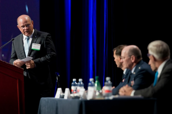 Scott Van Cleef, chairman of the board of the Air Force Association asks Lt. Gen. Stanley E. Clarke III, the director of the Air National Guard a question during the Total Force panel at the AFA's Air and Space Conference and Technology Exposition in National Harbor, Md., Sept. 16, 2015. The other members of the panel were Lt. Gen James Jackson, commander of the Air Force Reserve Command and chief of Air Force Reserves, Lt. Gen James Holmes, deputy chief of staff for Strategic Plans and Requirements and Daniel Sitterly, principal deputy Assistant Secretary of the Air Force for Manpower and Reserve Affairs. (U.S. Air National Guard photo/Master Sgt. Marvin R. Preston/Released)