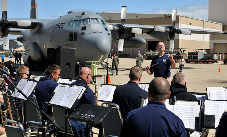 U.S. Air Force Lt. Col. Bryan M. Miller, commander of the 566th Air Force Band, Illinois Air National Guard, conducts a performance during Wingman and Family Day at the 182nd Airlift Wing, Peoria, Ill., Sept. 12, 2015. The event was organized to promote resiliency in Airmen and their friends and family. (U.S. Air National Guard photo by Staff Sgt. Lealan Buehrer/Released)