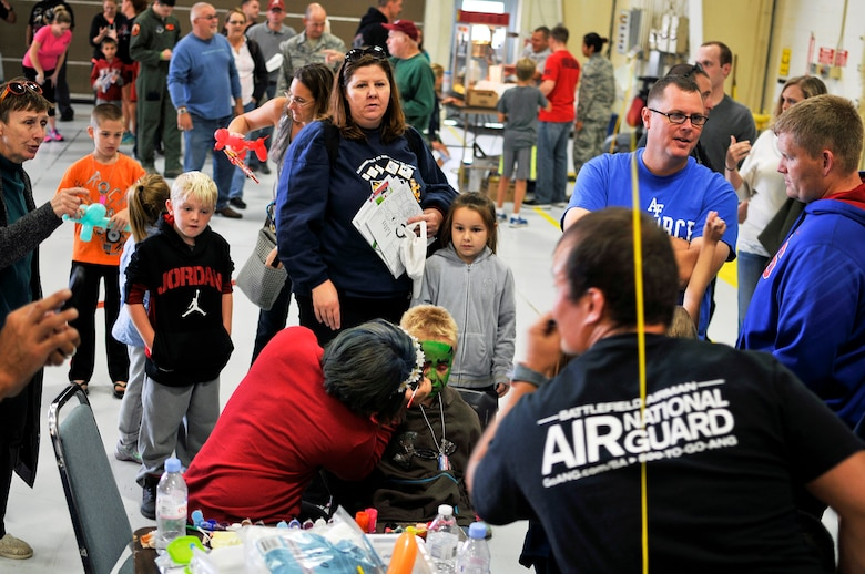 Friends, family and unit members of the 182nd Airlift Wing, Illinois Air National Guard, partake in popcorn, face painting and balloon animals during Wingman and Family Day at the 182nd Airlift Wing, Peoria, Ill., Sept. 12, 2015. The event was organized to promote resiliency in Airmen and their friends and family. (U.S. Air National Guard photo by Staff Sgt. Lealan Buehrer/Released)
