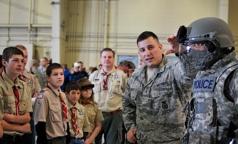 U.S. Air Force Senior Airman Scott J. Pericak, security specialist with the 182nd Security Forces Squadron, Illinois Air National Guard, explains his unit's domestic operations uniform configuration during Wingman and Family Day at the 182nd Airlift Wing, Peoria, Ill., Sept. 12, 2015. The event was organized to promote resiliency in Airmen and their friends and family. (U.S. Air National Guard photo by Staff Sgt. Lealan Buehrer/Released)