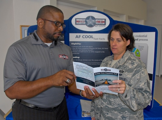Russell Gray, Air Force Credentialing Opportunities On-Line director, explains the AF COOL program to an Airman following a briefing at Eglin Air Force Base, Fla. The Air Force Installation Contracting Agency recently partnered with Air University and The Barnes Center for Enlisted Education to deliver a follow-on contract for AF COOL. (U.S. Air Force photo/Kevin Gaddie)