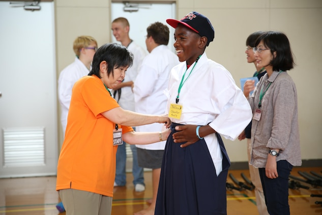 A student from Matthew C. Perry High School aboard Marine Corps Air Station Iwakuni, Japan prepares to perform a Japanese sword dance with his fellow class mates as well as students from Yanai City High School during a field trip August 22, 2015. The students dressed in traditional Japanese attire for the sword dance during their field trip to the Monk Gessho Exhibition Hall hosted by the Obatake Tourism Association.