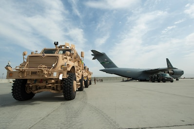 U.S. Army Mine-Resistant Ambush Protected vehicles are offloaded from an Air Force C-17 Globemaster III aircraft at Bagram Airfield, Afghanistan, Sept. 21, 2015. USAF cargo aircraft have transported 31,500 short tons of cargo throughout Afghanistan this year (U.S. Air Force photo by Tech. Sgt. Joseph Swafford/Released)