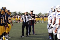 U.S. Marine Corps Staff Sgt. Ivory Carter III, a recruiter at Recruiting Sub-Station Cincinnati, gets ready to conduct the coin toss before a high school football game at Walnut Hills High School, Aug. 28, 2015. The Walnut Hills Eagles took on the Woodward Bulldogs during the U.S. Marines Battle of the Grid Iron Tour and took home the first Ohio victory of the season with a score of 23-0. (U.S. Marine Corps photo by Sgt. Jennifer Pirante/Released)