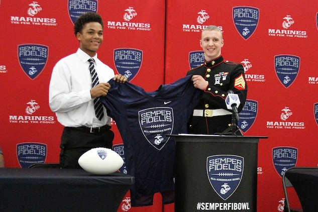 Sean Mahone, high school senior and cornerback for the Lakota West High School Firebirds, receives his Semper Fidelis All-American Bowl selection jersey during a pre-game meal Sept. 18, 2015. The Semper Fidelis Football Program focuses on mentoring exceptional youth athletes and future leaders by collectively celebrating academic excellence, proven physical fitness and quality of character. It also serves as an extension of the Marine Corps focus on developing quality citizens and reinforcing the value of public service. (U.S. Marine Corps photo by Sgt. Jennifer Pirante/Released)
