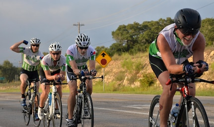 Competitors ride toward the next transition point during the 22-mile bike race portion of the annual Rambler 120 competition Sept. 19, 2015 at Joint Base San Antonio Recreation Park at Canyon Lake. The Rambler 120, which is hosted by the 502nd Force Support Squadron, features four- and eight-person teams that engage in a friendly, but hard-fought, competition that challenges participants with a 22-mile bike race, 6-mile run, 2-mile raft race and a mystery event. (U.S. Air Force photo by Your Olivia Mendoza)