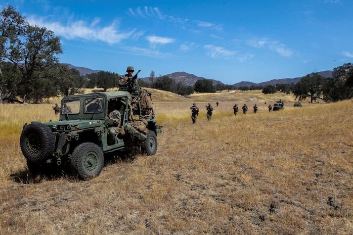 Marines with Company B, 1st Battalion, 1st Marine Regiment, 1st Marine Division, conduct a patrol at Fort Hunter Liggett, Calif., Aug. 25, 2015. The patrol was conducted as part of an experimental exercise designed to test Internally Transported Vehicle (ITVs) capabilities and discuss areas for improvement. The Marine Corps Warfighting Lab established the exercise to aid in the process of getting reliable information for future vehicle designs. (U.S. Marine Corps photo by Cpl. Joshua Murray)