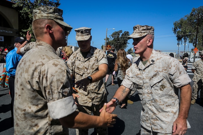 Sergeant Maj. Bradley Kasal, Sergeant Major of I Marine Expeditionary Force, congratulates new graduates from Field Medical Battalion-West during the 65th anniversary celebration of the training institution, and graduation ceremony of Field Medical Service Technician Class 2015-040, aboard Marine Corps Base Camp Pendleton, Calif., Sept. 18, 2015. FMTB-West opened its doors in the fall of 1950 and has trained young Sailors on life-saving techniques utilized on battlefields throughout history. (U.S. Marine Corps Photo by Sgt. Rick Hurtado / Released).