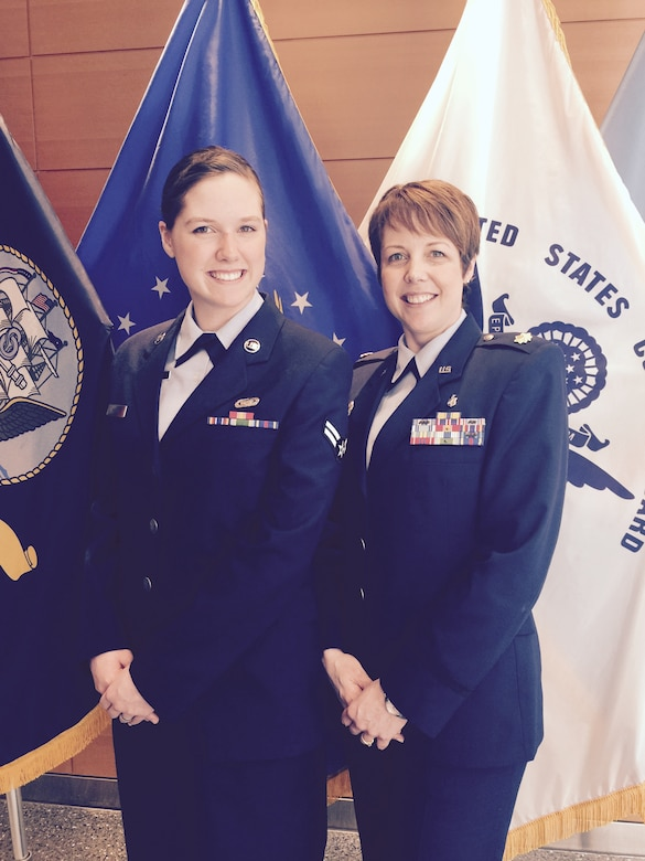 Then-Airman 1st Class Kara Watts and her mother, Maj. Tobie Wethington, attend the Air Force surgeon general's promotion at Defense Health Headquarters in Falls Church, Va., in 2015. Watts, now a senior airman and a 66th Comptroller Squadron administration specialist, and Wethington, an information management information technology fellow at the Defense Information Systems Agency, are both active-duty Airmen. (Courtesy photo)