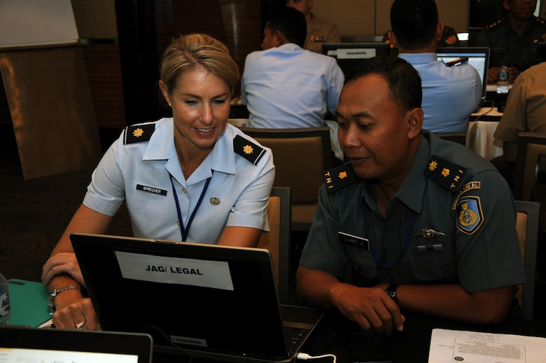 U.S. Air Force Maj. Leah Sprecher, Pacific Air Forces legal planner and Tentara Nasional Indonesia legal planner, and TNI Maj. Slamet discuss urban search and rescue legal considerations during exercise Gema Bhakti. Gema Bhakti, Indonesian for 'Echo of Good Deeds,' is a 10-day exercise designed to promote positive military relations, increase cultural awareness and enhance training and understanding of each other's capabilities. (U.S. Air Force photo by Capt. Joel Banjo-Johnson/Released)