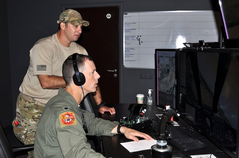 Lt. Col. John Marks, 303rd Fighter Squadron, Whiteman AFB, Missouri, trains with Air National Guard Joint Terminal Attack Controllers and Latvian military members in a simulator near Adazi Range in Latvia during a recent exercise. Marks received the Reserve Aircrew Award, the President's Award. During 2014 Marks deployed in support of Operation Enduring Freedom. He led 124 combat missions, supporting 132 ground operations and 29 troops-in-contact situations without friendly or civilian casualty. By his tactical expertise and instruction, the squadron achieved a 99.7 percent weapons effectiveness rate.   (U.S. Air Force photo/Capt. Denise Haeussler)