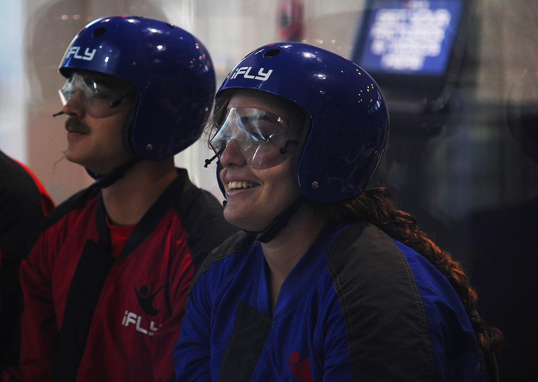 U.S. Air Force 2nd Lt. Amelia C. Beaton and Airman 1st Class Joel R. Steel, 315th Training Squadron students, wait for their turn inside the wind tunnel to experience simulated skydiving indoors at Austin, Texas, Sept. 19. The 17th Support Squadron at Goodfellow Air Force Base helps members on base have opportunities to experience fun events. (U.S. Air Force photo by Airman Caelynn Ferguson/Released)