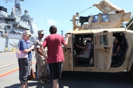 Corporal Seysha Lek, a motor transportation operator with 7th Engineer Support Battalion, explains the Humvees capabilities to onlookers during San Diego Fleet Week 2015 aboard Naval Base Coronado, Calif., Sept. 20, 2015. Thirty-seven Marines from 7th ESB presented static displays during the event to demonstrate the quality of military assets to the citizens of San Diego.