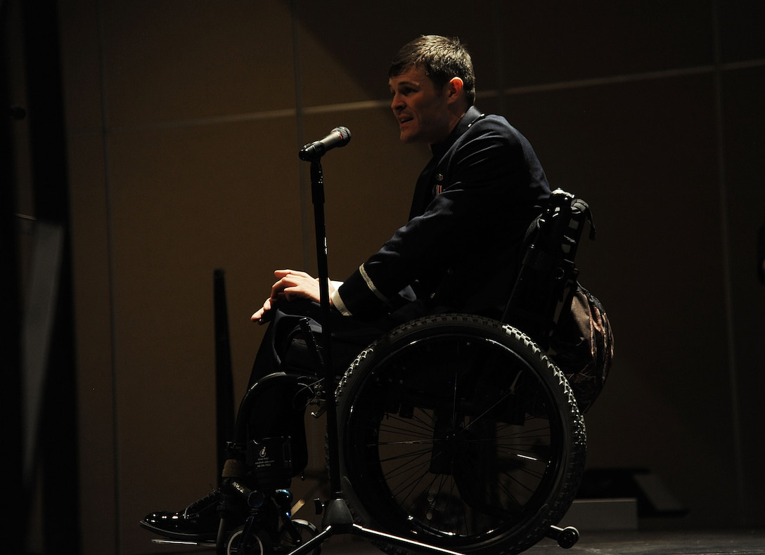 U.S. Air Force Capt. Nathan Nelson, 24th Special Operations Wing Special Tactics intelligence officer, gives a speech about his experiences after surviving a rocket blast in Afghanistan during the Goodfellow Air Force Ball at the McNease Convention Center in San Angelo, Texas, Sept. 18, 2015. Nelson goes on to explain his journey through rehabilitation and how Airmen should never stop giving their best no matter their circumstances. (U.S. Air Force photo by Airman Caelynn Ferguson/Released)