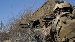 A Marine with Company A, 1st Reconnaissance Battalion, 1st Marine Division, fires behind cover at simulated targets during immediate action drills aboard Marine Corps Base Camp Pendleton, Calif., Sept. 9, 2015. The drills were part of a 2-week training schedule used to build on basic infantry skills for an upcoming deployment with a Marine Expeditionary Unit. (U.S. Marine Corps photo by Cpl. Tony Simmons/RELEASED)