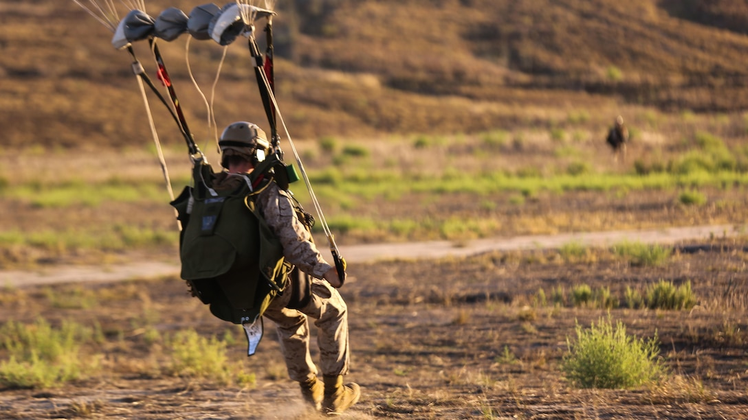 A Marine with 1st Reconnaissance Battalion, 1st Marine Division lands at his designated drop zone following a High Altitude – High Opening insertion event at Marine Corps Base Camp Pendleton, Calif., Sept. 17, 2015. The goal of the training was to sharpen a skill set that is of great advantage to expeditionary forces, allowing the jumpers to infiltrate locations where access would be too difficult for vehicles.