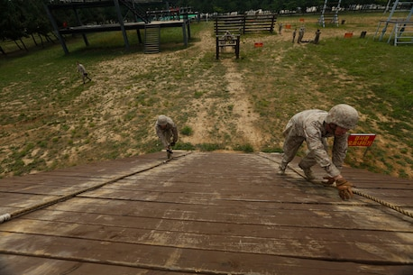 U.S. Marines attached to 2d Battalion, 3d Marines, Weapons Company, conduct a Republic of Korea Marine Corps obstacle course during Korean Marine Exchange Program 15-19 (KMEP) on Camp Mujuk, Republic of Korea, June 22, 2015. KMEP 15-19 provided an opportunity to train the units' complex Company and Battalion level collective tasks on dynamic, combined-arms ranges. (U.S. Marine Corps photo by MCIPAC Combat Camera Lance Cpl. Colby Cooper/Released)