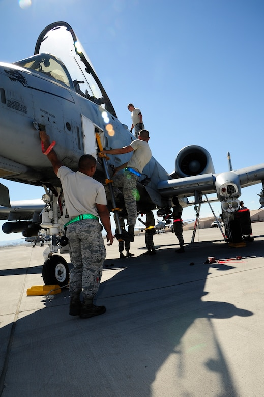 U.S. Airmen from the 355th Aircraft Maintenance Squadron recover an A-10 Thunderbolt II at Nellis Air Force Base, Nev., Sept 16, 2015. The 355th AMXS maintained eight A-10s from the 357th Fighter Squadron while participating in Green Flag-West 15-10. (U.S. Force photo by Senior Airman Betty R. Chevalier/Released)