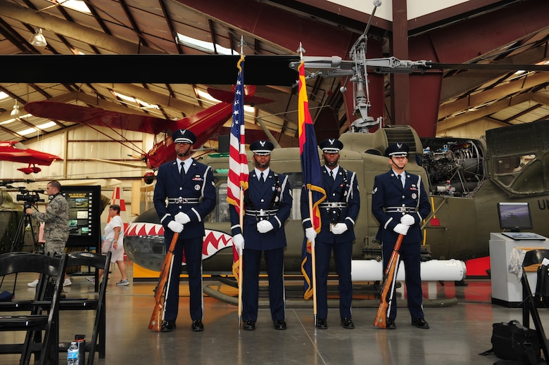 Davis-Monthan Air Force Base Honor Guardsmen, stand at parade rest prior to a POW/MIA Remembrance Ceremony at the Pima Air and Space Museum in Tucson, Ariz., Sept. 18, 2015. The ceremony was held to honor prisoners of war and those who are still missing in action. (U.S. Air Force photo by Senior Airman Cheyenne A. Powers/ Released)