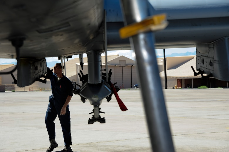 U.S. Air Force Airman 1st Class Michael Soto, 355th Aircraft Maintenance Squadron crew chief, checks an A-10 Thunderbolt II for damage or missing parts during a basic post flight inspection at Nellis Air Force Base, Nev., Sept. 16, 2015.  The 355th AMXS maintained eight A-10s from the 357th Fighter Squadron while participating in Green Flag-West 15-10. (U.S. Air Force photo by Senior Airman Betty R. Chevalier/Released)