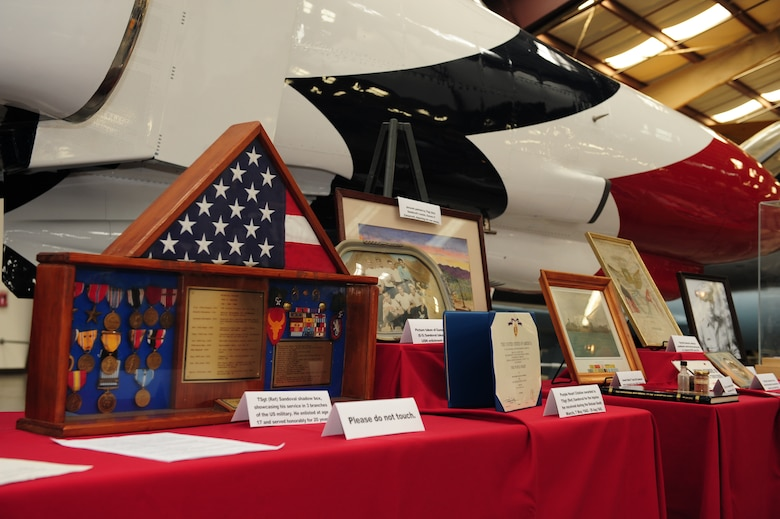 Prisoner of war memorabilia is displayed during a POW/MIA Remembrance Ceremony at the Pima Air and Space Museum in Tucson, Ariz., Sept. 18, 2015. Local Tucson POW veterans who were captured during World War II, Vietnam and the Korean War provided memorabilia from their experiences as POWs to be displayed during the ceremony. (U.S. Air Force photo by Senior Airman Cheyenne A. Powers/ Released)