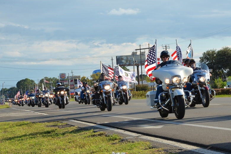 PANAMA CITY, Fla. - Proudly flying the Colors, motorcyclists lead the the escort detail for the Warrior Beach Retreat parade event Sept. 17. All along the route, which went from Panama City Beach to a local church in Panama City, well wishers  paid tribute to the wounded warriors with flags, waves and rendering salutes. The Retreat honors wounded warriors by bringing them and their spouse or caregiver to Panama City Beach, Fla., for a week of rest and relaxation. (Air Force Photo Released/Capt. Jared Scott)