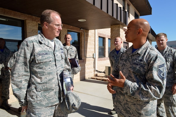 Air Force Senior Master Sgt. Andre Bellamy, 43rd Air Mobility Squadron operations superintendent, right, briefs Brig. Gen. James Scanlan, mobilization assistant to the U.S. Air Force Expeditionary Center commander, left, about aerial port and aircraft maintenance operations during Scanlan's visit to Pope Army Airfield, North Carolina, Sept. 17-18. (U.S. Air Force photo/Marvin Krause)