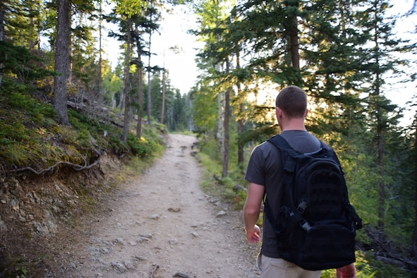 Airman 1st Class Matt Hinson, 28th Comptroller Squadron financial customer service technician, hikes down the No.4 Harney Peak trail in the Black Hills National Park, S.D., Sept. 12, 2015. Hinson uses hiking as a way to relax and recuperate from work and enjoy the outdoors before the winter arrives. (U.S. Air Force photo by Airman 1st Class James L. Miller/Released)