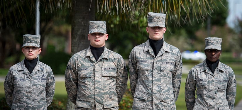 A Joint Base Charleston Honor Guard detail stands at parade rest while waiting for reveille to sound during the POW/MIA retreat ceremony Sept. 18, 2015, at the base flag pole on JB Charleston – Air Base, S.C. The ceremony included a 21-gun salute by the Honor Guard, a wreath-laying and a live bugle performance in recognition of captured and missing U.S. servicemembers. (U.S. Air Force photo/Airman 1st Class Clayton Cupit)