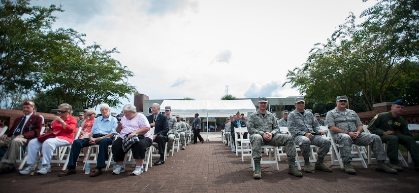 Members of Joint Base Charleston wait for the POW/MIA retreat ceremony to begin Sept. 18, 2015, at the base flagpole on JB Charleston – Air Base, S.C. The ceremony included a 21-gun salute by the Honor Guard, a wreath-laying and a live bugle performance in recognition of captured and missing U.S. servicemembers. (U.S. Air Force photo/Airman 1st Class Clayton Cupit)