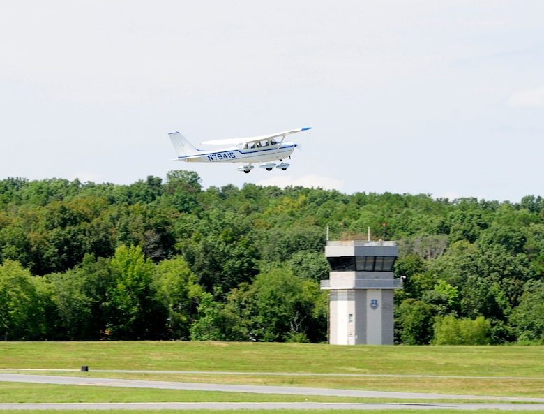 Members of the 235th Air Traffic Control Squadron, communicate from the control tower at Stanly County Airport in New London, N.C., with Roger Mabry, a student pilot of Pressley Aviation, as he takes off in a Cessna Skyhawk, August 31, 2015. The 235th ATC has provided air traffic control services for all civilian and military aircraft since their infrastructure started in 1988 when they formed a partnership with Stanly County Airport. (U.S. Air National Guard photo by Master Sgt. Patricia F. Moran, 145th Public Affairs/Released)