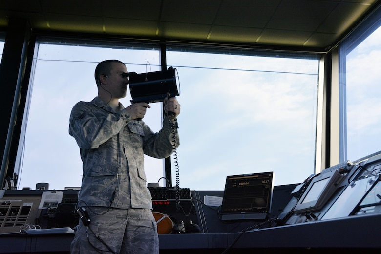U.S. Air Force Senior Airman Justin W. Condon, 235th Air Traffic Control Squadron, local controller for airborne aircraft, conducts a light gun signal check with approaching aircraft, July 8, 2105. This device is used as a means of communicating with aircraft in case of radio failure. The 235th ATCS provides air traffic control services for all civilian and military aircraft at the Stanly County Airport, New London, N.C. (U.S. Air National Guard photo by Master Sgt. Patricia F. Moran, 145th Public Affairs/Released)