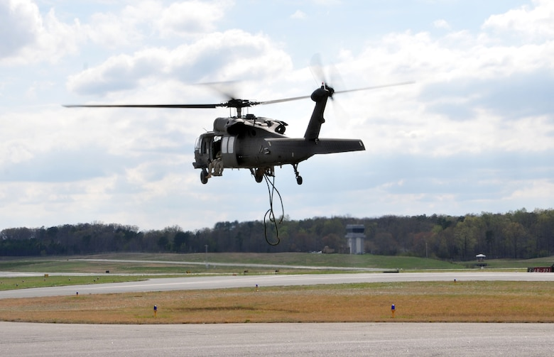 Members of the 118th Air Support Operations Squadron communicate with 235th Air Traffic Controllers who watch the skies from the control tower at Stanly County Airport, New London, N.C., April 8, 2015, while Soldiers from North Carolina Army National Guard, Company C, 1-131 AVN, conduct FAST rope insertion training from UH-60 Blackhawk helicopter. The 235th ATC has provided air traffic control services for all civilian and military aircraft since their infrastructure started in 1988 when they formed a partnership with Stanly County Airport. (U.S. Air National Guard photo by Master Sgt. Patricia F. Moran, 145th Public Affairs/Released)